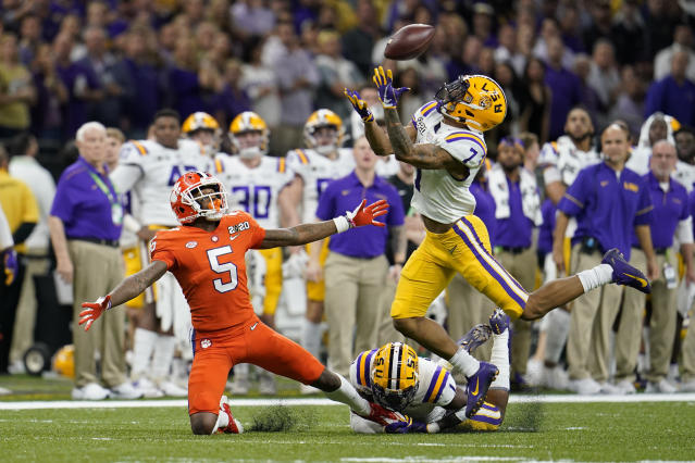 FILE - In this Jan. 13, 2020, file photo, LSU safety Grant Delpit, right, breaks up a pass intended for Clemson wide receiver Tee Higgins during the first half of a NCAA College Football Playoff national championship game in New Orleans. Delpit was selected by the Cleveland Browns in the second round of the NFL football draft Friday, April 24, 2020. (AP Photo/David J. Phillip, File)