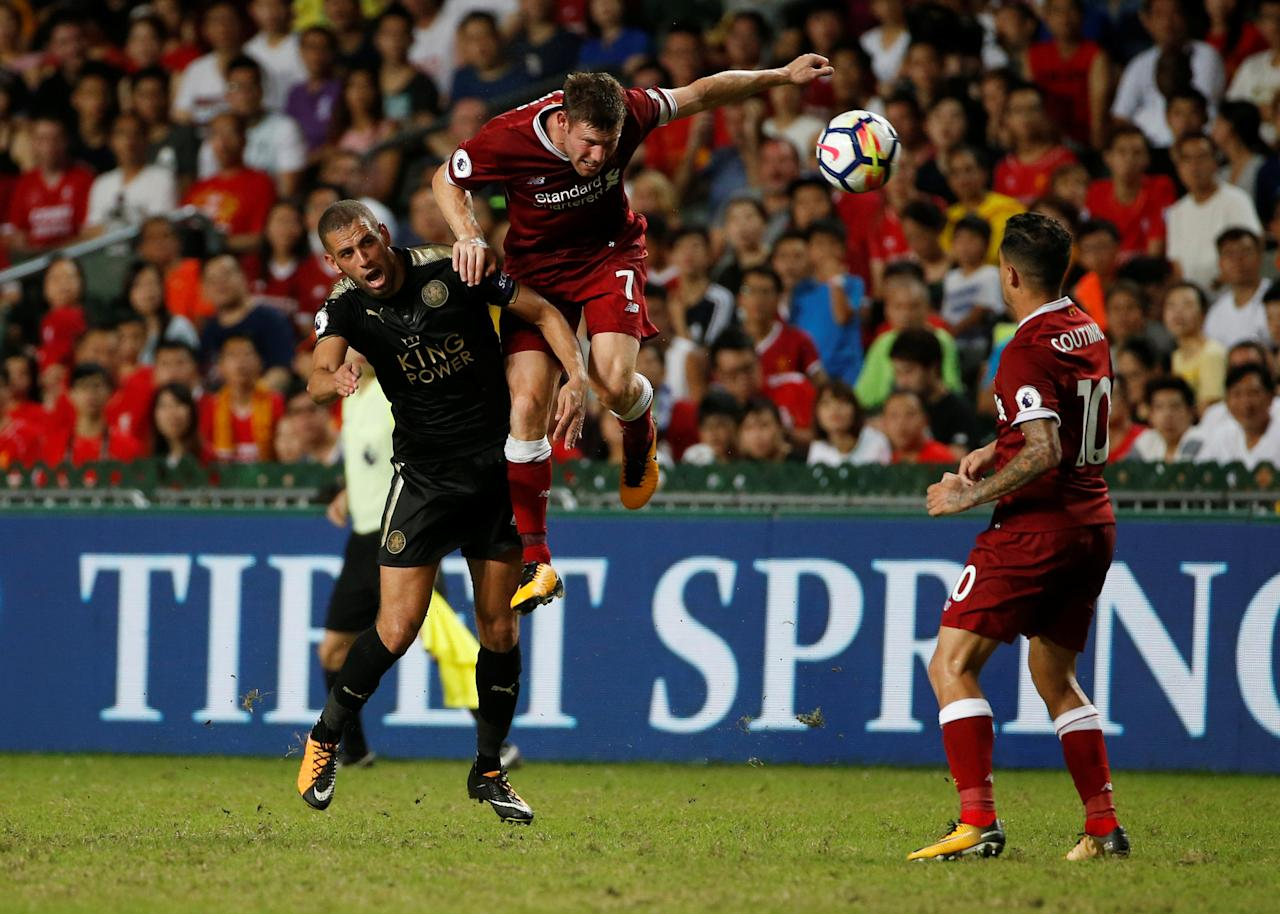 Soccer Football - Leicester City v Liverpool - Pre Season Friendly - The Premier League Asia Trophy - Final - June 22, 2017   Liverpool's James Milner in action with Leicester City's Islam Slimani    REUTERS/BOBBY YIP