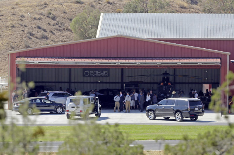 """FILE - In this Wednesday, July 6, 2016 file photo, members of a film crew stand at Agua Dulce Airpark, a small, rural airport in Agua Dulce, Calif., in northern Los Angeles County.   Records show that actor Tom Sizemore was not supposed to drive a vehicle during the filming of a scene for the """"Shooter"""" television series in which he ran over a stuntman, leaving him seriously injured. Multiple people working on the show told a workplace safety investigator for Cal/OSHA that Sizemore was not following the script when he drove the sport utility vehicle away from a shootout scene.(AP Photo/Reed Saxon)"""
