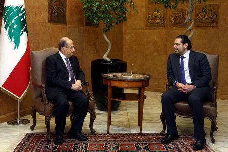 Lebanon's President Michel Aoun (L) meets with Prime Minister Saad al-Hariri at the Presidential Palace in Baabda