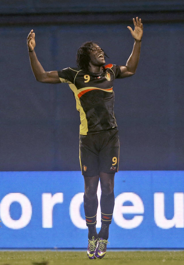 Belgium's Romelu Lukaku, celebrates scoring his side's second goal against Croatia, during their group A World Cup qualifying soccer match in Zagreb, Friday, Oct. 11, 2013. (AP Photo/Darko Bandic)