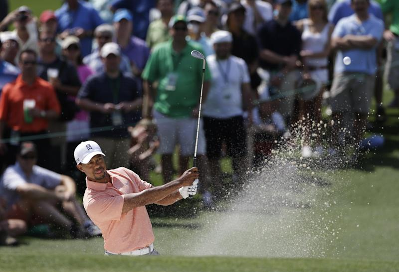 Tiger Woods watches his shot out of a bunker on the second hole during a practice round for the Masters golf tournament Tuesday, April 9, 2013, in Augusta, Ga. (AP Photo/Darron Cummings)