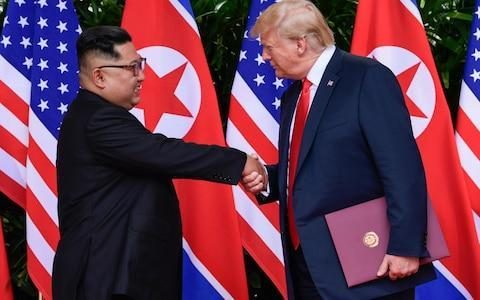 <span>Kim Jong Un and Donald Trump agreed to work towards the complete denculiarisation of Korea</span> <span>Credit: AP </span>