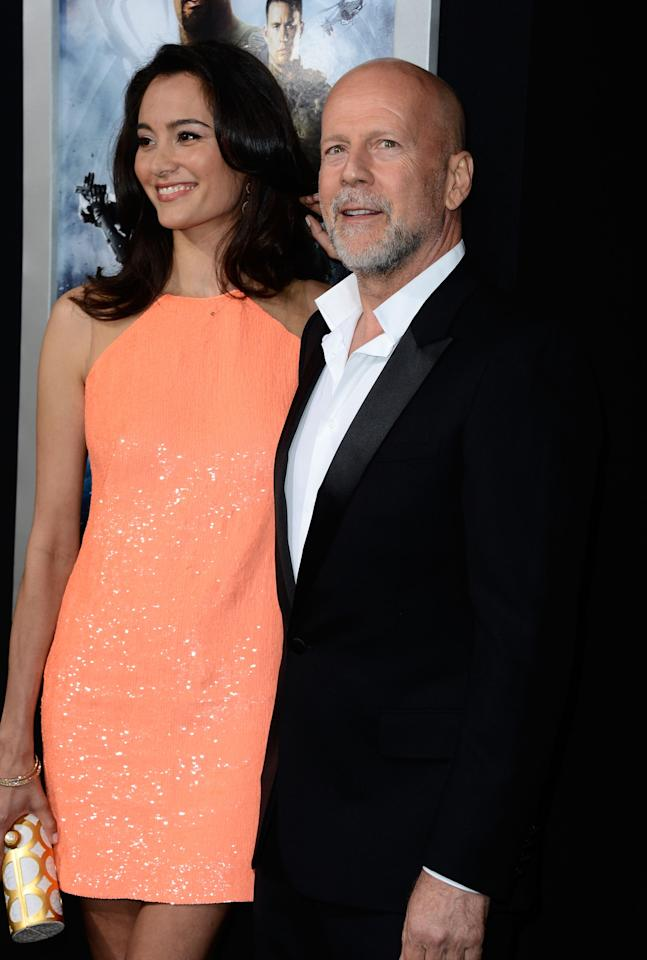"""HOLLYWOOD, CA - MARCH 28:  Emma Heming and actor Bruce Willis arrive at the Premiere of Paramount Pictures' """"G.I. Joe: Retaliation"""" at TCL Chinese Theatre on March 28, 2013 in Hollywood, California.  (Photo by Frazer Harrison/Getty Images)"""