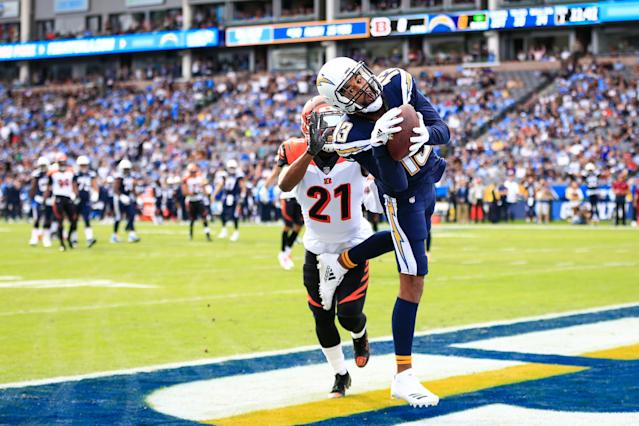 <p>Wide receiver Keenan Allen #13 of the Los Angeles Chargers makes a catch in front of defensive back Darqueze Dennard #21 of the Cincinnati Bengals for a touchdown in the first quarter to lead 7-0 at StubHub Center on December 9, 2018 in Carson, California. (Photo by Sean M. Haffey/Getty Images) </p>