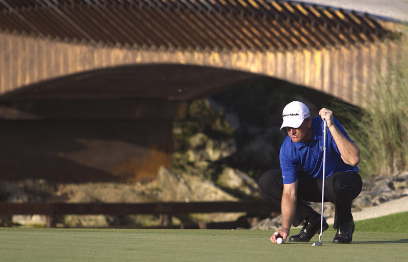Robert Karlsson from the Sweden lines up his putt on the third green during the third day of the OHL Classic at Mayacoba golf tournament in Quintana Roo, Mexico, Saturday, Nov. 16, 2013. (AP Photo/Christian Palma)