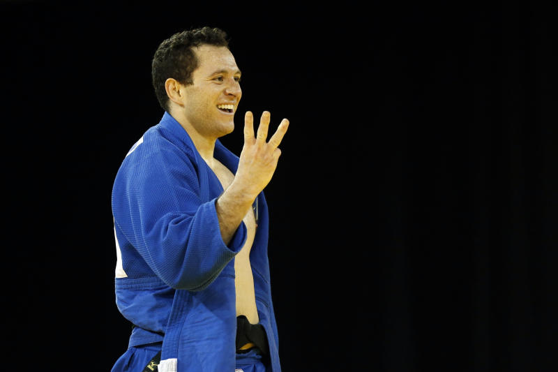 Brazil's Tiago Camilo gestures after beating Cuba's Asley Gonzalez during the men's -90kg gold medal judo match at the Pan Am Games, Monday, July 13, 2015, in Mississauga, Ontario. (AP Photo/Julio Cortez)