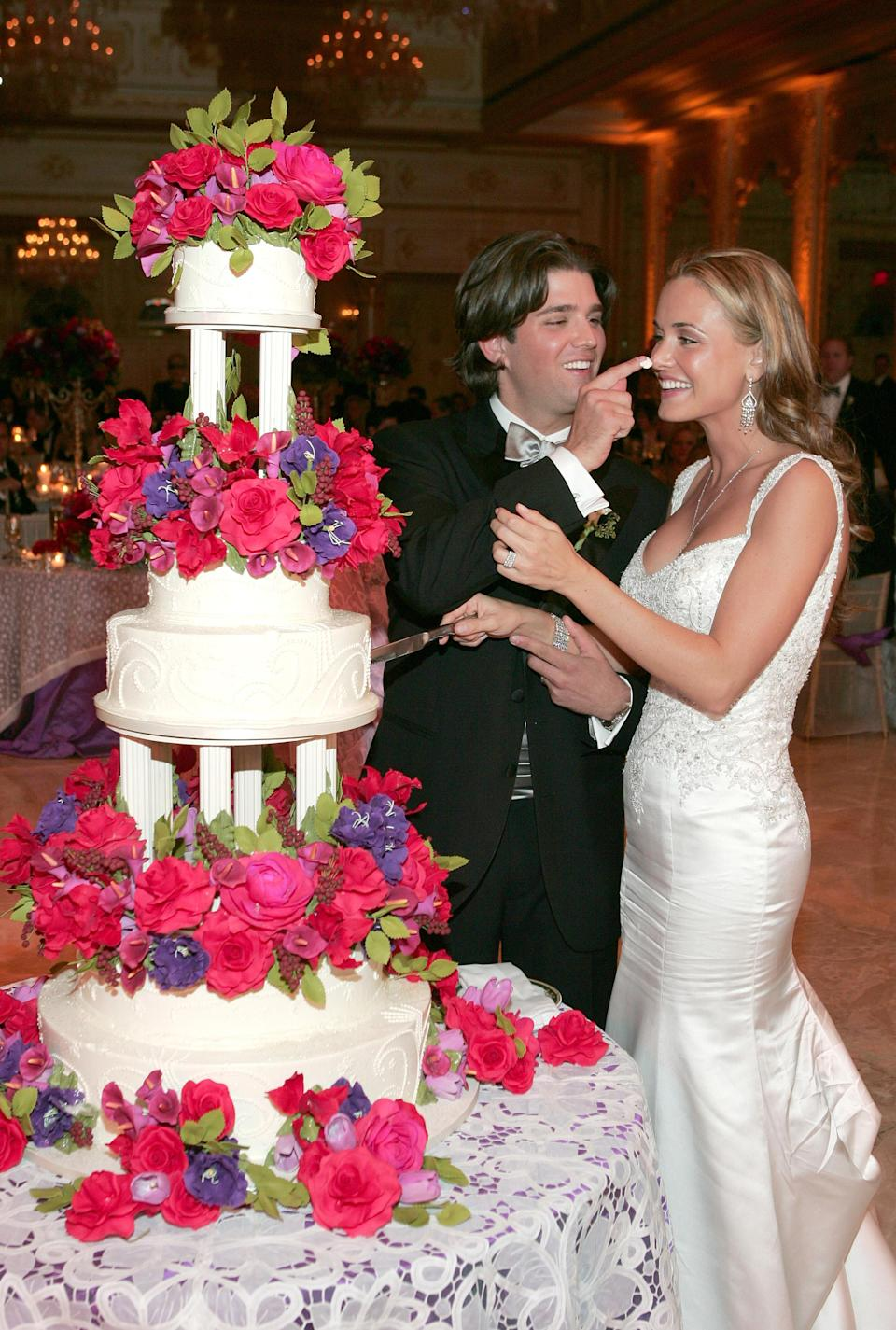 Donald Trump Jr. and Vanessa Trump cut a slice of wedding cake at their wedding reception at Mar-a-Lago in November 2005. (Photo: Michelle McMinn Photography/Getty Images)