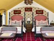 """<p>The vivid ochre yellow paint on the vaulted ceilings of a Utah guest bedroom by designer <a href=""""https://www.anthonybaratta.com"""" rel=""""nofollow noopener"""" target=""""_blank"""" data-ylk=""""slk:Anthony Baratta"""" class=""""link rapid-noclick-resp"""">Anthony Baratta</a> complements the colors of the folk-inspired <a href=""""https://www.pierrefrey.com/en/"""" rel=""""nofollow noopener"""" target=""""_blank"""" data-ylk=""""slk:Pierre Frey"""" class=""""link rapid-noclick-resp"""">Pierre Frey</a> wallpaper. The custom four-poster beds are covered in a <a href=""""http://www.christopherhyland.com"""" rel=""""nofollow noopener"""" target=""""_blank"""" data-ylk=""""slk:Christopher Hyland"""" class=""""link rapid-noclick-resp"""">Christopher Hyland</a> checked fabric. <br></p>"""