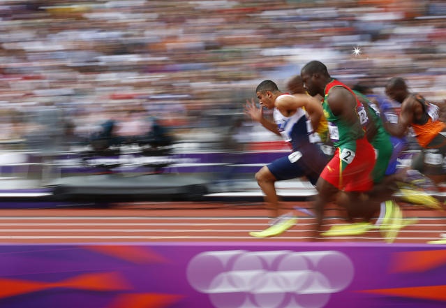 Britain's Adam Gemili leads during heat 5 of the round 1 men's 100m heats at the London 2012 Olympic Games at the Olympic Stadium August 4, 2012. Gemili finished second in his heat. REUTERS/Kai Pfaffenbach (BRITAIN - Tags: OLYMPICS SPORT ATHLETICS TPX IMAGES OF THE DAY)