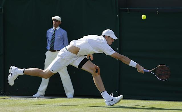 John Isner of U.S. reaches out for a return to Daniel Smethurst of Britain during their first round match at the All England Lawn Tennis Championships in Wimbledon, London, Tuesday, June 24, 2014. (AP Photo/Ben Curtis)