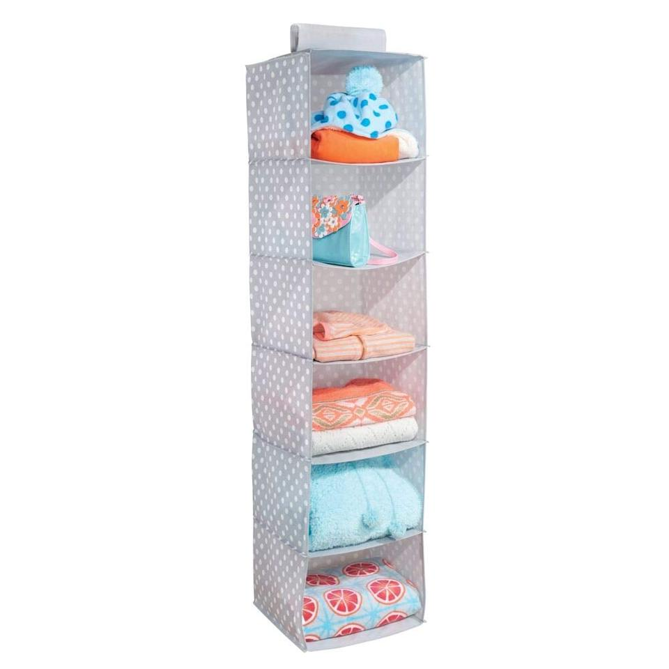 """<p>You can store clothes, towels, shoes, and more on this <a href=""""https://www.popsugar.com/buy/mDesign%20Soft%20Fabric%20Over%20Closet%20Rod%20Hanging%20Storage%20Organizer-471016?p_name=mDesign%20Soft%20Fabric%20Over%20Closet%20Rod%20Hanging%20Storage%20Organizer&retailer=amazon.com&price=13&evar1=casa%3Aus&evar9=46407279&evar98=https%3A%2F%2Fwww.popsugar.com%2Fhome%2Fphoto-gallery%2F46407279%2Fimage%2F46407752%2FmDesign-Soft-Fabric-Over-Closet-Rod-Hanging-Storage-Organizer&list1=shopping%2Corganizing%2Chome%20organization%2Chome%20shopping&prop13=mobile&pdata=1"""" rel=""""nofollow"""" data-shoppable-link=""""1"""" target=""""_blank"""" class=""""ga-track"""" data-ga-category=""""Related"""" data-ga-label=""""https://www.amazon.com/mDesign-Hanging-Storage-Organizer-Shelves/dp/B073X34X12?ref_=bl_dp_s_web_11456418011"""" data-ga-action=""""In-Line Links"""">mDesign Soft Fabric Over Closet Rod Hanging Storage Organizer</a> ($13).</p>"""
