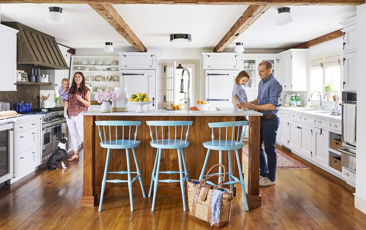 """<p>A group of four simple, flush-mount fixtures with a slightly larger center fixture means every inch of the kitchen is properly lit. The symmetrical arrangement within the exposed beams adds even more visual interest to the ceiling. Pro tip: Install fixtures on their own switches so you can turn lights in certain areas on and off as you desire. </p><p><a class=""""body-btn-link"""" href=""""https://go.redirectingat.com?id=74968X1596630&url=https%3A%2F%2Fwww.wayfair.com%2Flighting%2Fpdp%2Fbirch-lane-heritage-sudbury-1-light-semi-flush-mount-bl10012.html&sref=http%3A%2F%2Fwww.countryliving.com%2Fhome-design%2Fdecorating-ideas%2Fg28249059%2Fkitchen-lighting-ideas%2F"""" target=""""_blank"""">SHOP NOW</a></p>"""