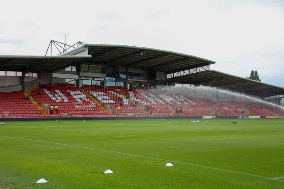 """This photo provided by Wrexham FC shows the empty stands of the Racecourse Ground in Wrexham, Wales, Saturday, Sept. 11, 2021. It has been described as a """"crash course in football club ownership"""" and the two Hollywood stars who bought a beleaguered team in English soccer's fifth tier with the lofty aim of transforming it into a global force are certainly learning on the job. (Gemma Thomas/Wrexham FC via AP)"""