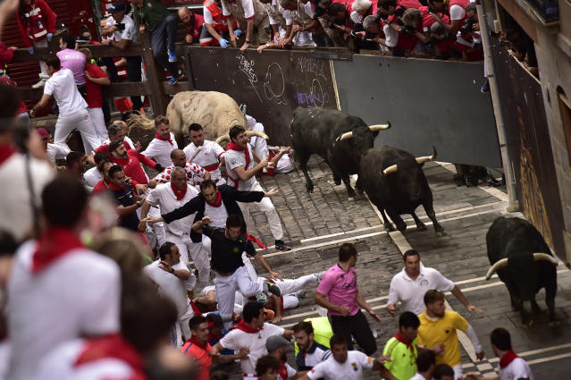 <p>Revellers run in front of Jandilla's fighting bulls during the running of the bulls at the San Fermin Festival, in Pamplona, northern Spain, July 11, 2017. (AP Photo/Alvaro Barrientos) </p>