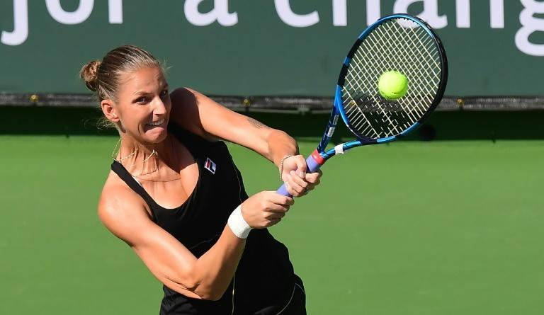 Czech Karolina Pliskova hits a backhand return to Beatriz Haddad Maia of Brazil during their third round match at the WTA Indian Wells tournament in California (AFP/Frederic J. BROWN)