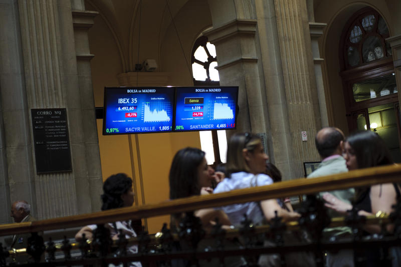 Spanish bank Bankia's values are displayed on screens at the Stock Exchange in Madrid, Monday, May 28, 2012. Shares in Spanish bank Bankia, one of the banks hardest hit by Spain's real estate collapse over the past four years, fell 28 per cent on opening in Madrid on Monday, the bank's first day back on the stock exchange following its announcement Friday that it would need Euro 19 billion ($23.8 billion) bailout to bolster its defenses.(AP Photo/Daniel Ochoa de Olza)