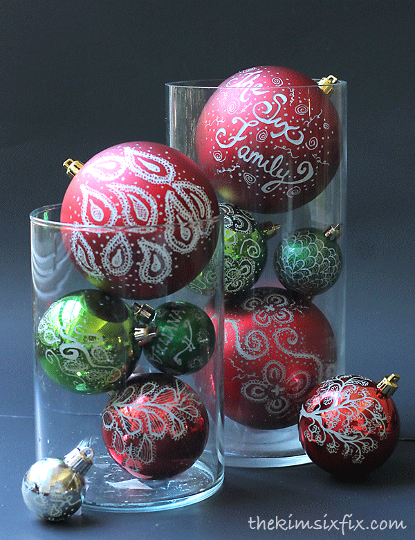"""<p>Use red and green ornaments if you want to keep it classic, or switch it up with brightly colored bulbs. </p><p>Get the tutorial at <a href=""""http://www.thekimsixfix.com/2014/09/engraved-and-illuminated-ornaments.html"""" rel=""""nofollow noopener"""" target=""""_blank"""" data-ylk=""""slk:The Kim Six Fix"""" class=""""link rapid-noclick-resp"""">The Kim Six Fix</a>.</p>"""
