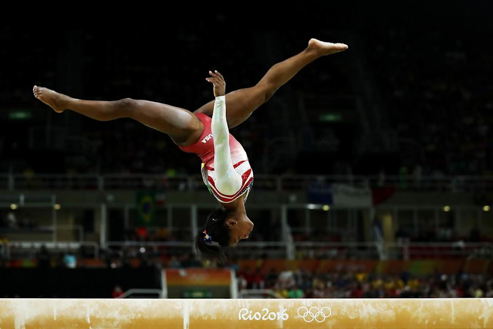 <p>Simone Biles of the United States competes on the balance beam during the Artistic Gymnastics Women's Team Final on Day 4 of the Rio 2016 Olympic Games at the Rio Olympic Arena on August 9, 2016 in Rio de Janeiro, Brazil. (Photo by Lars Baron/Getty Images) </p>