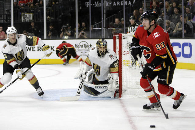 Vegas Golden Knights goaltender Marc-Andre Fleury (29) guards the net against Calgary Flames center Sam Bennett (93) during the first period of an NHL hockey game Friday, Nov. 23, 2018 in Las Vegas. (AP Photo/Joe Buglewicz)