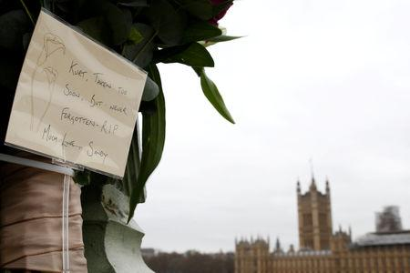 FILE PHOTO: Messages left on Westminster Bridge by members of the public to pay their respects on the anniversary of the terror attack in London, Britain, March 22, 2018. REUTERS/Henry Nicholls/File Photo
