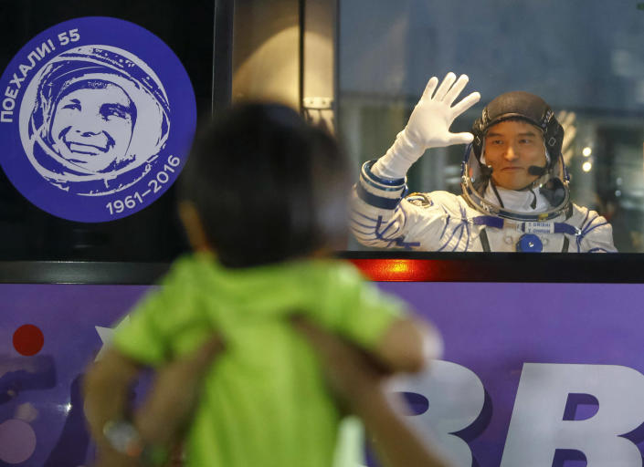 <p>Japanese astronaut Takuya Onishi, member of the main crew to the International Space Station (ISS), waves to his relatives from a bus prior the launch of Soyuz-FG rocket at the Russian leased Baikonur cosmodrome, Kazakhstan, Thursday, July 7, 2016. (AP Photo/Shamil Zhumatov, pool) </p>
