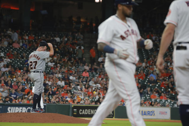 Detroit Tigers' Jordan Zimmerman, left, steps off the mound after walking Houston Astros' Martin Maldonado in the third inning of a baseball game Thursday, Aug. 22, 2019, in Houston. (AP Photo/Richard Carson)