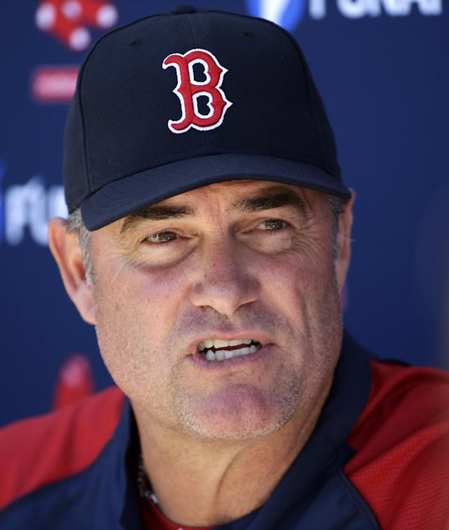 Boston Red Sox manager John Farrell faces reporters during spring training baseball practice Tuesday, Feb. 18, 2014, in Fort Myers, Fla. (AP Photo/Steven Senne)