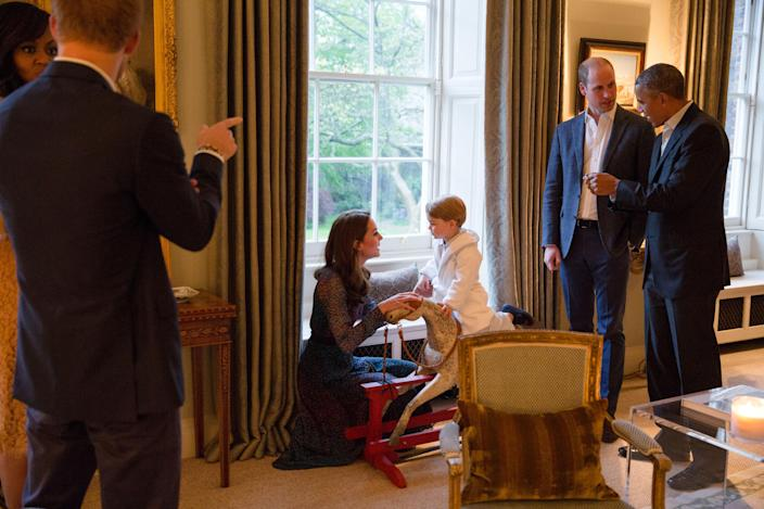 Prince George got to meet Barack Obama, while wearing his dressing gown. (Pete Souza/The White House via Getty Images)