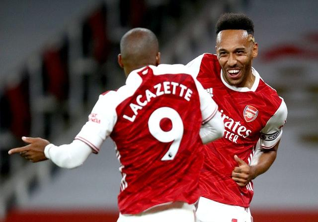 Lacazette, left, headed home Pierre-Emerick Aubameyang's cross