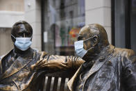 Face coverings on the statues of former US President Franklyn D. Roosevelt, left, and former British Prime Minister Winston Churchill in Mayfair, London, Sunday, Feb. 7, 2021, as the third national lockdown, due to the COVID-19 outbreak, continues. (AP Photo/Alberto Pezzali)