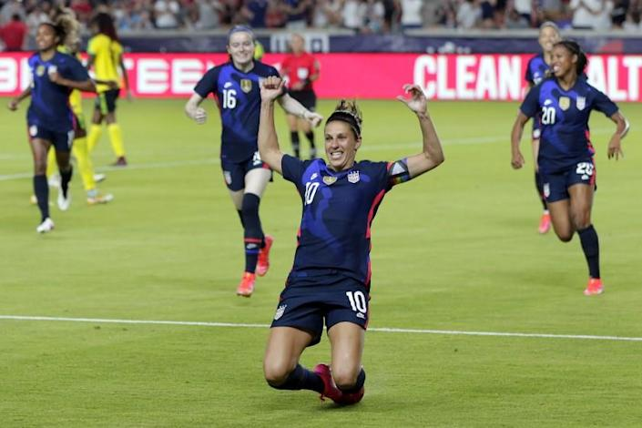 U.S. forward Carli Lloyd (10) slides on the turf after scoring in the first minute against Jamaica.