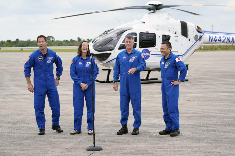 SpaceX Crew 2 astronauts, from left, European Space Agency astronaut Thomas Pesquet, NASA astronaut Megan McArthur, NASA astronaut Shane Kimbrough and Japan Aerospace Exploration Agency astronaut Akihiko Hoshide greet members of the media after they arrived at the Kennedy Space Center in Cape Canaveral, Fla., Friday, April 16, 2021. The launch to the International Space Station is targeted for April 22. (AP Photo/John Raoux)