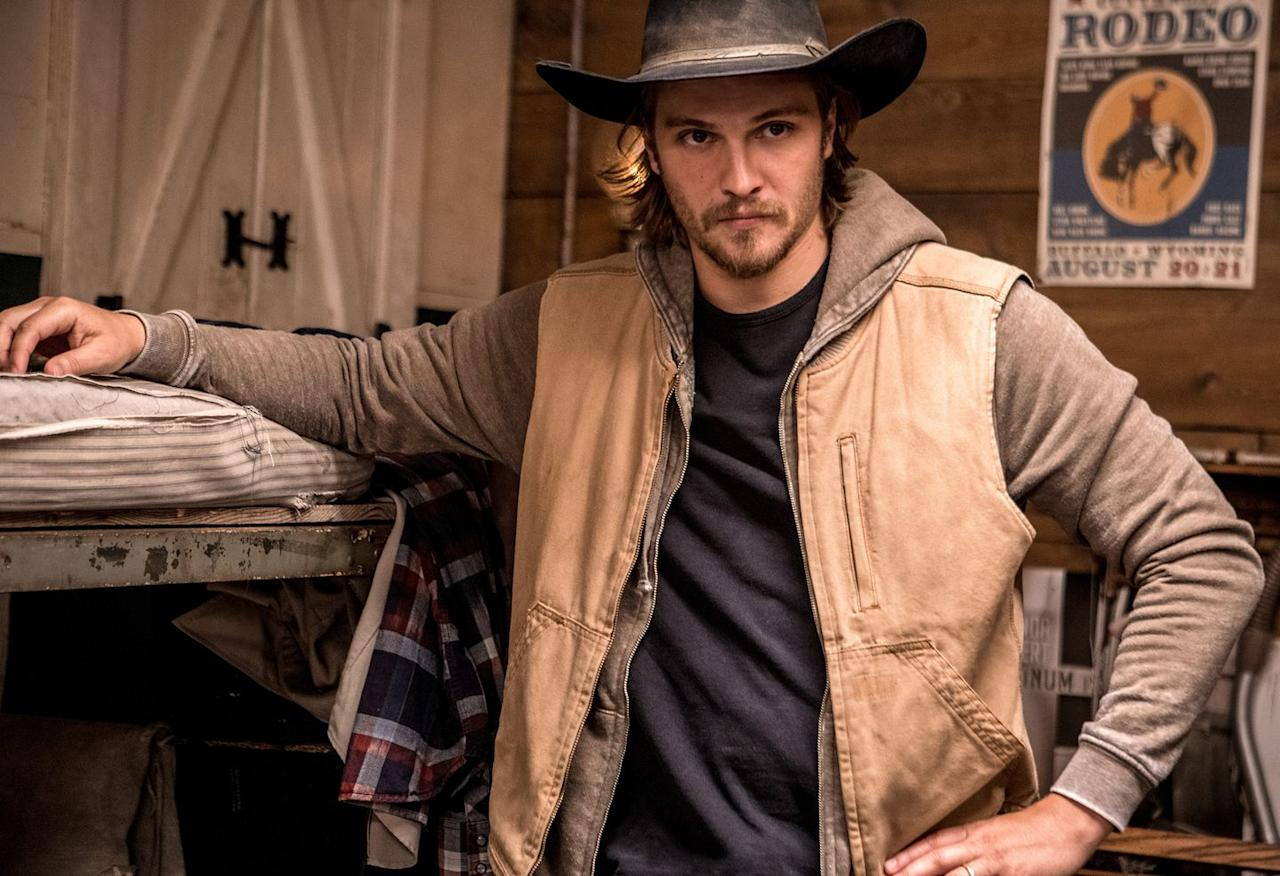 <p>Kayce Dutton is getting a major promotion in <em>Yellowstone </em>season 2, when his father, John, entrusts him with overseeing the ranch. But it definitely won't be an easy road, as he'll face troubles with other characters like Rip Wheeler (Cole Hauser) along the way. You'll likely recognize actor Luke from <em>The Magnificent Seven, True Blood</em>, and the <em>Fifty Shades of Grey </em>franchise.</p>