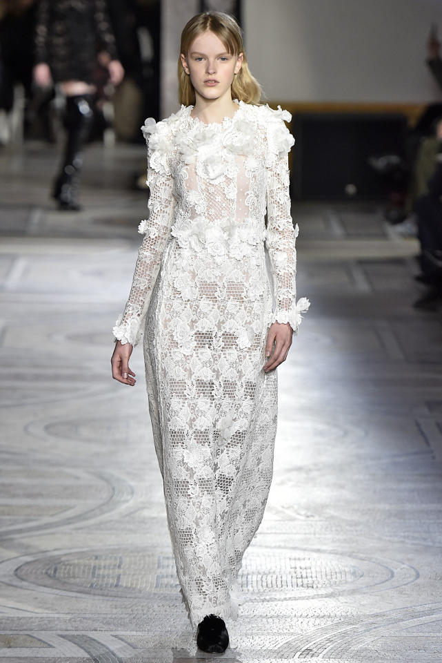 <p>This Giambattista Valli couture piece is but a more subdued version of the previous. It's easy to imagine a few alterations (like a sheath beneath the lace to manage the naked dress look) on Markle. (Photo: Getty Images) </p>