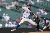 Los Angeles Dodgers starting pitcher Julio Urias throws against the Seattle Mariners in the first inning of a baseball game Tuesday, April 20, 2021, in Seattle. (AP Photo/Ted S. Warren)
