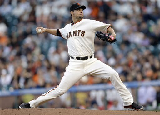 San Francisco Giants starting pitcher Ryan Vogelsong throws to the Arizona Diamondbacks during the first inning of a baseball game on Monday, April 22, 2013 in San Francisco. (AP Photo/Marcio Jose Sanchez)
