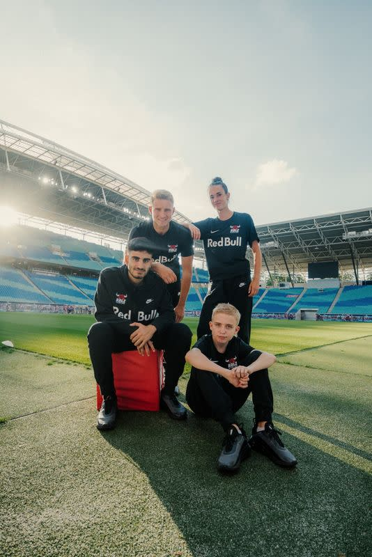 FIFA 21 gamer Anders Vejrgang poses for a photo with his team members of the RB Leipzig Gaming at the Red Bull Arena in Leipzig