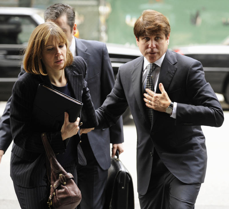 FILE - In this May 2, 2011 file photo, former Illinois Gov. Rod Blagojevich and wife Patti arrive at federal court for final jury selection and opening statements in his second corruption trial in Chicago. Blagojevich's attorneys have said they will call prominent people to testify in their defense of the former governor in his corruption retrial.  (AP Photo/Paul Beaty, File)