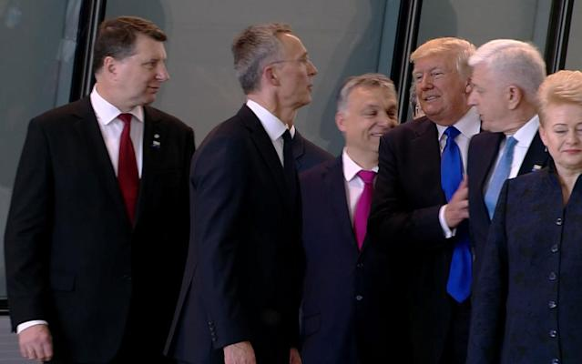 <p>In this image taken from NATO TV, Montenegro Prime Minister Dusko Markovic, second right, appears to be pushed by US President Donald Trump as they were given a tour of NATO's new headquarters after taking part in a group photo, during a NATO summit of heads of state and government in Brussels on Thursday, May 25, 2017. (Photo: NATO TV via AP) </p>