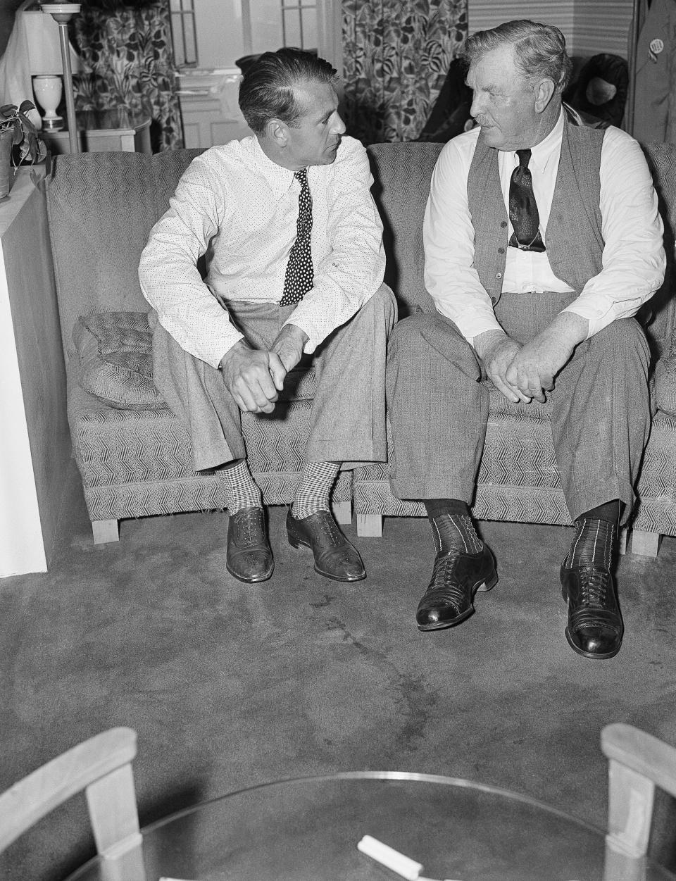 """FILE—In this file photo from July 1, 1941, actor Gary Cooper, left, who played the title role in the movie """"Sergeant York,"""" talks with Sgt. Alvin York, on whose life the movie was based, at a New York hotel. The claim in Pennsylvania state Sen. Doug Mastriano's 2014 book about York, that a 1918 U.S. Army Signal Corps photo was mislabeled and actually shows York with three German officers he captured, has been disputed by rival researchers. (AP Photo, File)"""