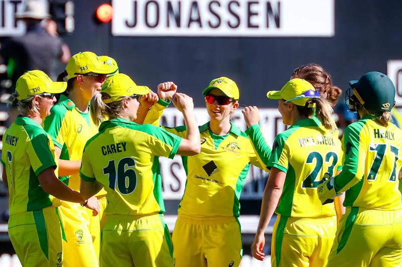 Australian players celebrate the dismissal of New Zealand's Amy Satterthwaite during the third one-day international match.