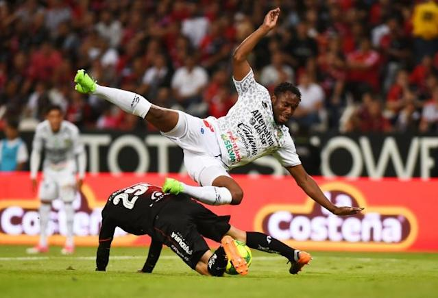 A file photo of Sao Tome e Principe captain Luis Leal (R) playing for Mexican club Chiapas (AFP Photo/HECTOR GUERRERO)