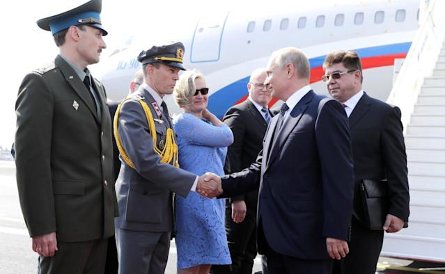 <p>Russian President Vladimir Putin is welcomed as he arrives at airport to meet with U.S. President Donald Trump in Helsinki, Finland on July 16, 2018. (Photo: Kremlin Press Office/Handout/Anadolu Agency/Getty Images) </p>