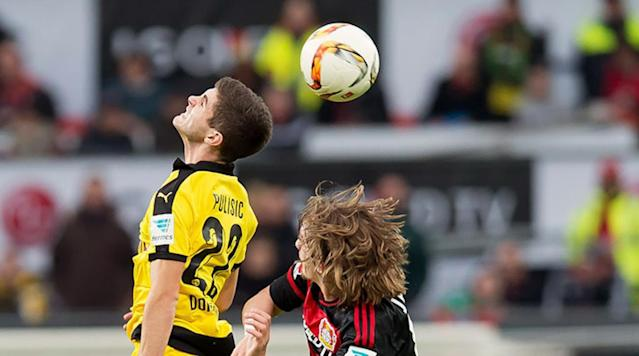 <p>Christian Pulisic of Borussia Dortmund with a header against Tin Jedvaj of Bayer Leverkusen on Feb. 21, 2016.</p>