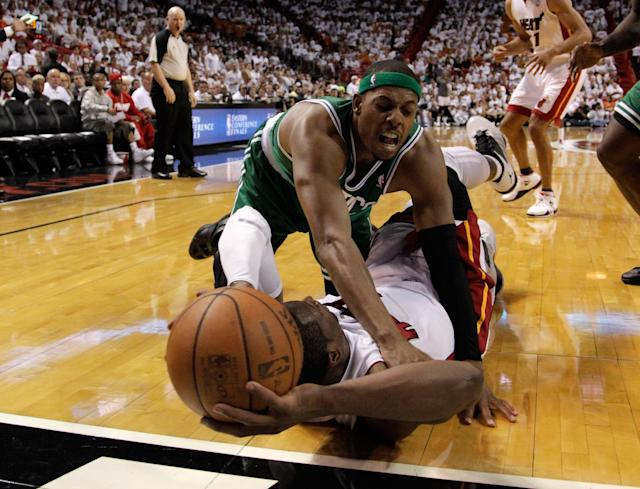 MIAMI, FL - JUNE 09: Paul Pierce #34 of the Boston Celtics attempts to block a pass from Dwyane Wade #3 of the Miami Heat in the third quarter in Game Seven of the Eastern Conference Finals in the 2012 NBA Playoffs on June 9, 2012 at American Airlines Arena in Miami, Florida. NOTE TO USER: User expressly acknowledges and agrees that, by downloading and or using this photograph, User is consenting to the terms and conditions of the Getty Images License Agreement. (Photo by Mike Ehrmann/Getty Images)