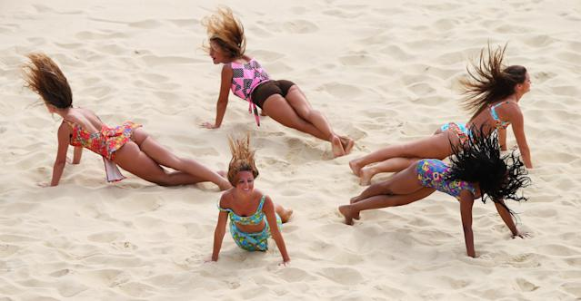 LONDON, ENGLAND - JULY 28: Cheerleaders perform during Women's Beach Volleyball match between China and Russia on Day 1 of the London 2012 Olympic Games at Horse Guards Parade on July 28, 2012 in London, England. (Photo by Ryan Pierse/Getty Images)