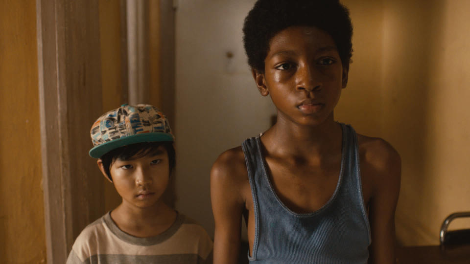 """This photo released by Lions Gate Entertainment, Inc. shows Skylan Brooks, right, as Mister and Ethan Dizon as Pete in a scene from the film, """"The Inevitable Defeat of Mister & Pete."""" Starring alongside Jennifer Hudson, Anthony Mackie, Jeffrey Wright and Jordin Sparks, the young actors offer moving portrayals of Mister and Pete, two boys forsaken by their drug addict mothers and left to fend for themselves through a sweltering summer. The film releases Friday, Oct. 11, 2013. (AP Photo/Copyright Lions Gate Entertainment, Inc.)"""