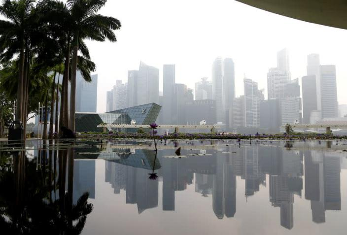 FILE PHOTO: The financial district is seen shrouded by haze in Singapore