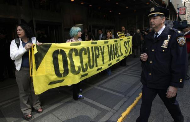 Occupy Wall Street demonstrators protest against Republican Presidential candidate and former Massachusetts Governor Mitt Romney outside the Waldorf Astoria Hotel in New York where Romney was holding a fundraiser March 14, 2012.